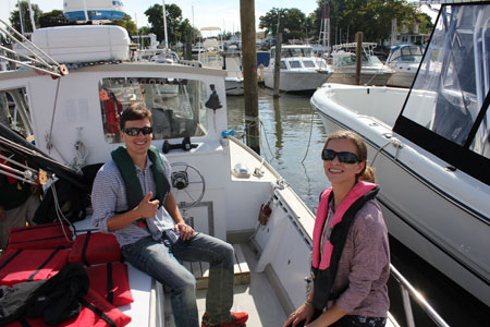 student interns sitting on a boat